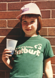 Image is a young girl in a Flatbush shirt